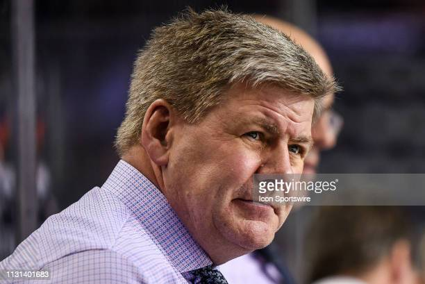 Head coach for the Calgary Flames Bill Peters watches warm ups before an NHL game where the Calgary Flames hosted the New York Rangers on March 15 at...