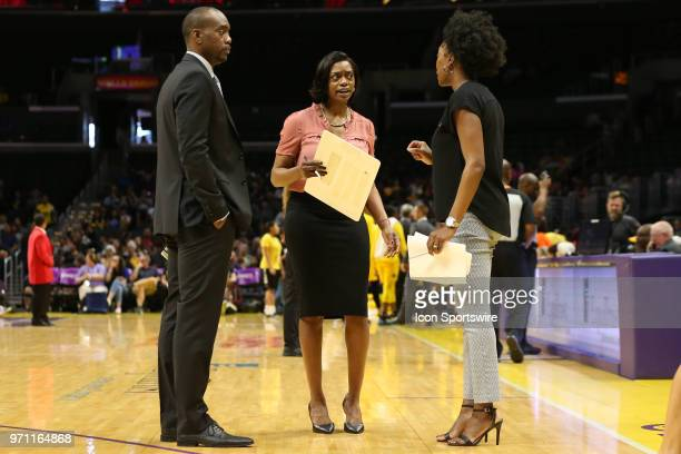 Head coach for the Chicago Sky Amber Stocks talks to her assistant coaches Awvee Storey and Carla D Morrow during a WNBA game between the Los Angeles...