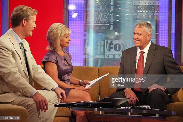 Head coach for the New York Jets Rex Ryan with hosts Steve Doocy and Gretchen Carlson at 'FOX Friends' at the FOX Studios on July 19 2012 in New York...