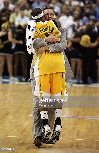 Head coach Fran McCaffery and Tay Fisher of the Siena Saints celebrate their team's 8362 win over the Vanderbilt Commodores during the first round of...