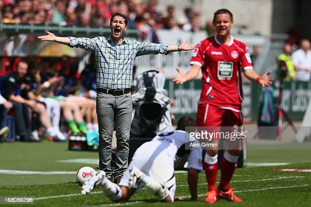 Head coach Franco Foda and Chris Loewe of Kaiserslautern react during the Second Bundesliga match between 1 FC Kaiserslautern and FSV Frankfurt at...