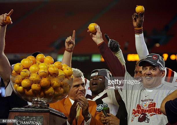 Head coach Frank Beamer of the Virginia Tech Hokies celebrates after defeating the Cincinnati Bearcats to win the FedEx Orange Bowl at Dolphin...