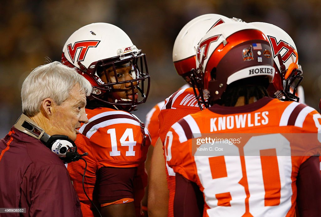 Head coach Frank Beamer of the Virginia Tech Hokies converses with players during a timeout against the Georgia Tech Yellow Jackets at Bobby Dodd Stadium on November 12, 2015 in Atlanta, Georgia.