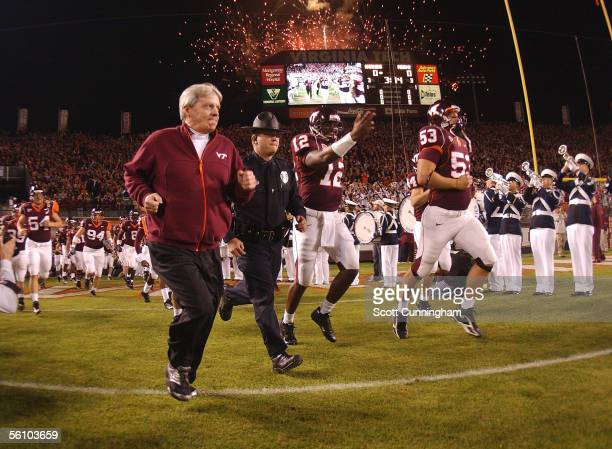 Head coach Frank Beamer of the Virginia Tech Hokies leads his team on to the field before the game against the Miami Hurricanes on November 5 2005 in...