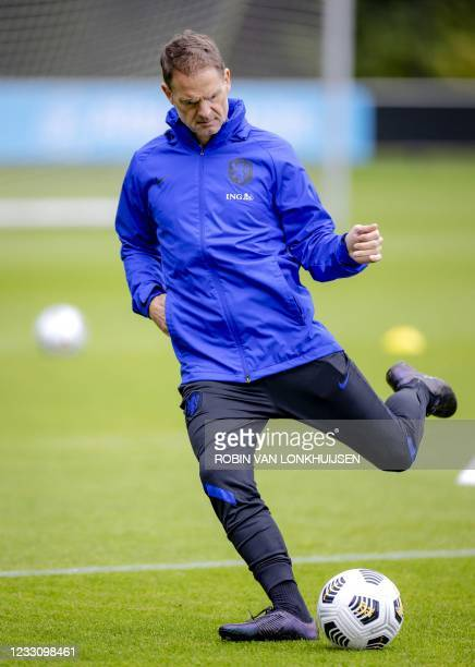 Head coach Frank de Boer kicks the ball as Dutch national football team players attend a training session at the KNVB Campus on May 25, 2021 in...