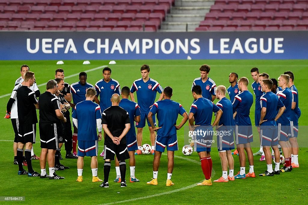 Head coach Frank de Boer of AFC Ajax gives instructions to his players during a training session ahead of their UEFA Champions League Group F match against FC Barcelona at Camp Nou Stadium on October 20, 2014 in Barcelona, Spain.