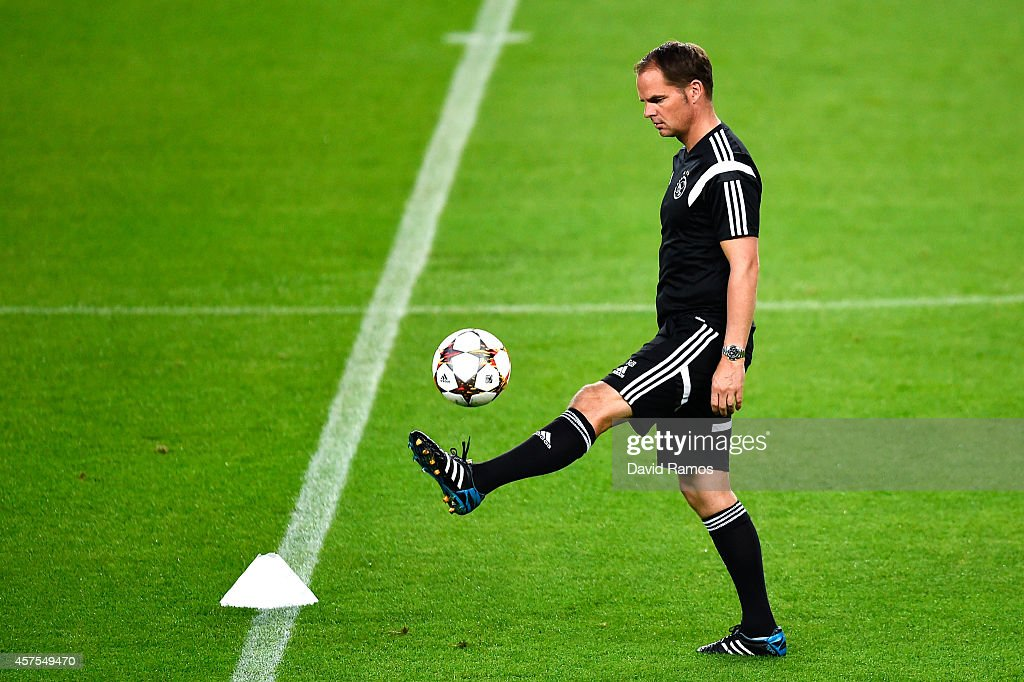 Head coach Frank de Boer of AFC Ajax juggles the ball during a training session ahead of their UEFA Champions League Group F match against FC Barcelona at Camp Nou Stadium on October 20, 2014 in Barcelona, Spain.