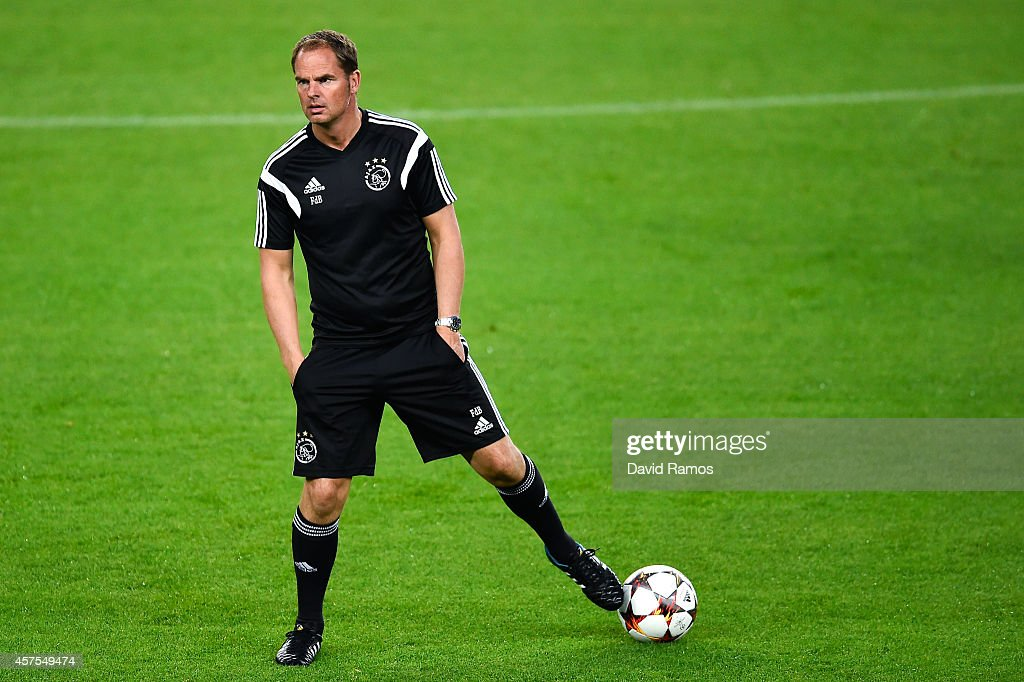 Head coach Frank de Boer of AFC Ajax looks on during a training session ahead of their UEFA Champions League Group F match against FC Barcelona at Camp Nou Stadium on October 20, 2014 in Barcelona, Spain.