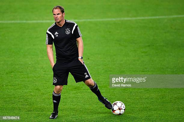 Head coach Frank de Boer of AFC Ajax looks on during a training session ahead of their UEFA Champions League Group F match against FC Barcelona at...