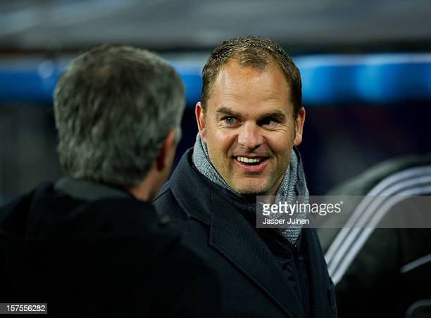 Head coach Frank De Boer of Ajax Amsterdam smiles as he is greeted by Head coach Jose Mourinho of Real Madrid during the UEFA Champions League Group...