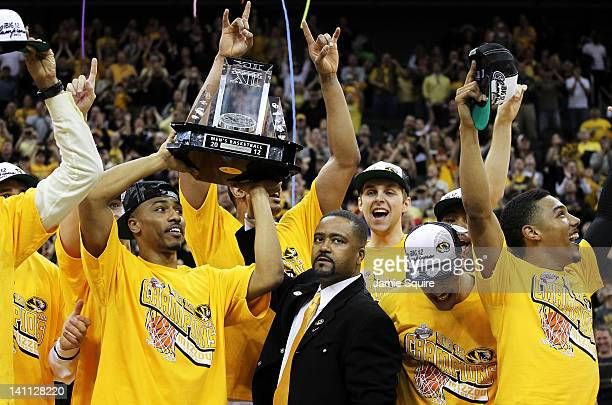 Head coach Frank Haith and the Missouri Tigers celebrate with the trophy after defeating the Baylor Bears to win the championship game of the 2012...