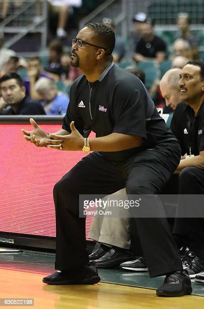 Head coach Frank Haith of the Tulsa Golden Hurricane tries to get his point across to the officials during the first half of the Diamond Head Classic...