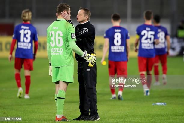 Head coach Frank Heinemann of Krefeld comforts Robin Benz of Krefeld after during the 3 Liga match between KFC Uerdingen 05 and 1 FC Kaiserslautern...