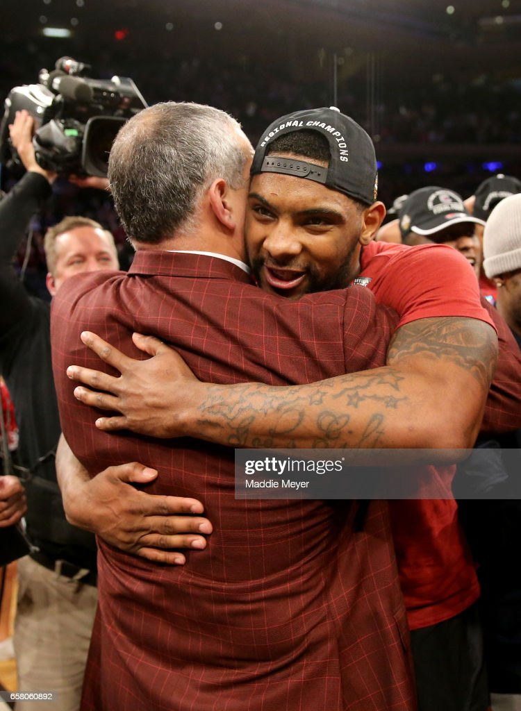 Head coach Frank Martin and Sindarius Thornwell #0 of the South Carolina Gamecocks celebrate after defeating the Florida Gators with a score of 77 to 70 to win the 2017 NCAA Men's Basketball Tournament East Regional at Madison Square Garden on March 26, 2017 in New York City.