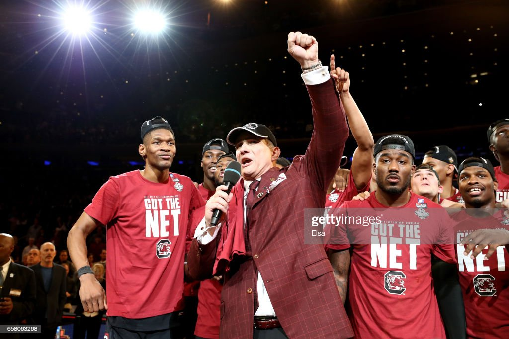 Head coach Frank Martin of he South Carolina Gamecocks celebrate with his team after defeating the Florida Gators with a score of 77 to 70 to win the 2017 NCAA Men's Basketball Tournament East Regional at Madison Square Garden on March 26, 2017 in New York City.