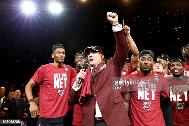 Head coach Frank Martin of he South Carolina Gamecocks celebrate with his team after defeating the Florida Gators with a score of 77 to 70 to win the...