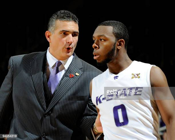 Head coach Frank Martin of the Kansas State Wildcats talks with guard Jacob Pullen during the second half against the Washington State Cougars on...
