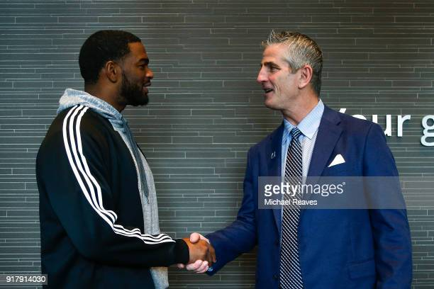 Head coach Frank Reich of the Indianapolis Colts talks with Jacoby Brissett following his introductory press conference at Lucas Oil Stadium on...