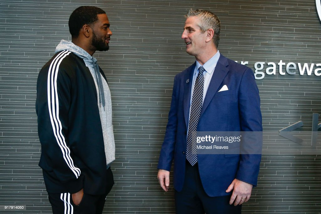 Head coach Frank Reich of the Indianapolis Colts talks with Jacoby Brissett following his introductory press conference at Lucas Oil Stadium on February 13, 2018 in Indianapolis, Indiana.
