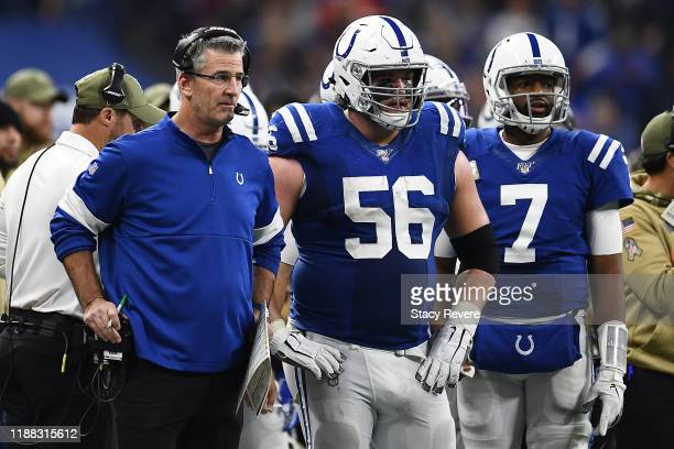 Head coach Frank Reich of the Indianapolis Colts waits for a review with Quenton Nelson and Jacoby Brissett during a game against the Jacksonville...