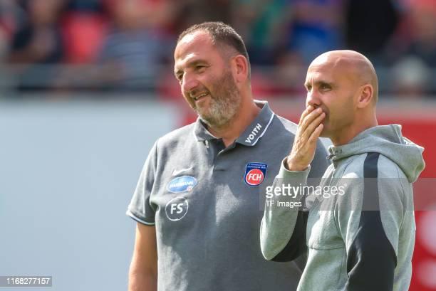 Head coach Frank Schmidt of 1. FC Heidenheim and head coach Andre Schubert of Holstein Kiel looks on during the Second Bundesliga match between 1. FC...