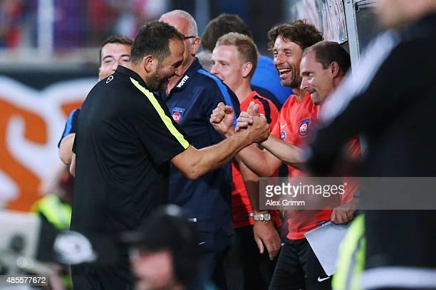 Head coach Frank Schmidt of Heidenheim and team mates celebrate after the Second Bundesliga match between 1. FC Heidenheim and 1. FC Kaiserslautern...