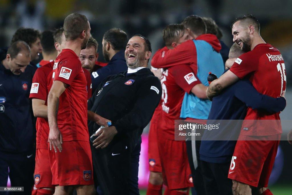 Head coach Frank Schmidt of Heidenheim celebrates with the team after the Second Bundesliga match between SV Sandhausen and 1. FC Heidenheim 1846 at BWT-Stadion am Hardtwald on November 24, 2017 in Sandhausen, Germany.