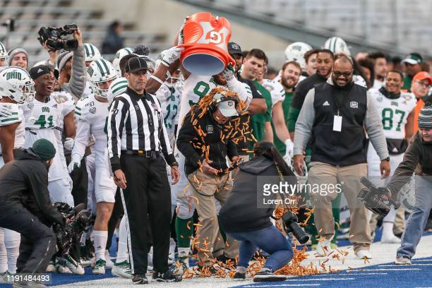 Head Coach Frank Solich of the Ohio Bobcats gets showered with french fries during second half action against the Nevada Wolf Pack at the Famous...