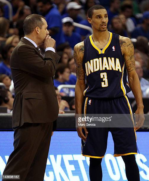 Head coach Frank Vogel of the Indiana Pacers chats with Guard George Hill against the Orlando Magic in Game Three of the Eastern Conference...