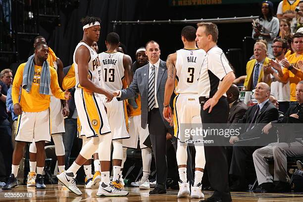Head coach Frank Vogel of the Indiana Pacers speaks to the team after a play against the Toronto Raptors during Game Three of the Eastern Conference...