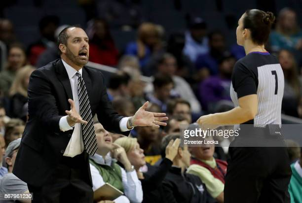Head coach Frank Vogel of the Orlando Magic reacts to a call during their game against the Charlotte Hornets at Spectrum Center on October 29 2017 in...