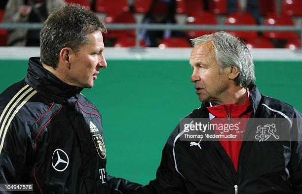 Head coach Frank Wormuth of Germany talks to head coach Martin Tuempler of Switzerland after the men's U20 International friendly match between...
