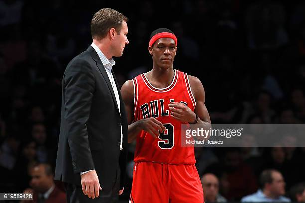 Head coach Fred Hoiberg and Rajon Rondo of the Chicago Bulls talk on the sideline during the second half at Barclays Center on October 31 2016 in New...
