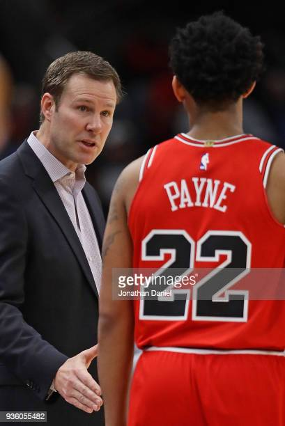 Head coach Fred Hoiberg of the Chicago Bulls gives instructions to Cameron Payne during a game against the Denver Nuggets at the United Center on...