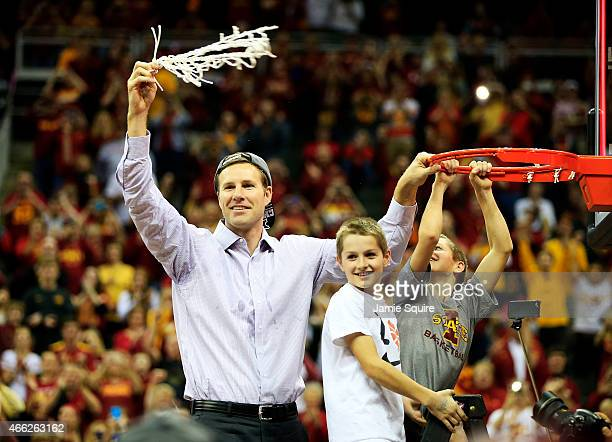 Head coach Fred Hoiberg of the Iowa State Cyclones cuts down a piece of the net after their 70 to 66 victory over the Kansas Jayhawks during the...