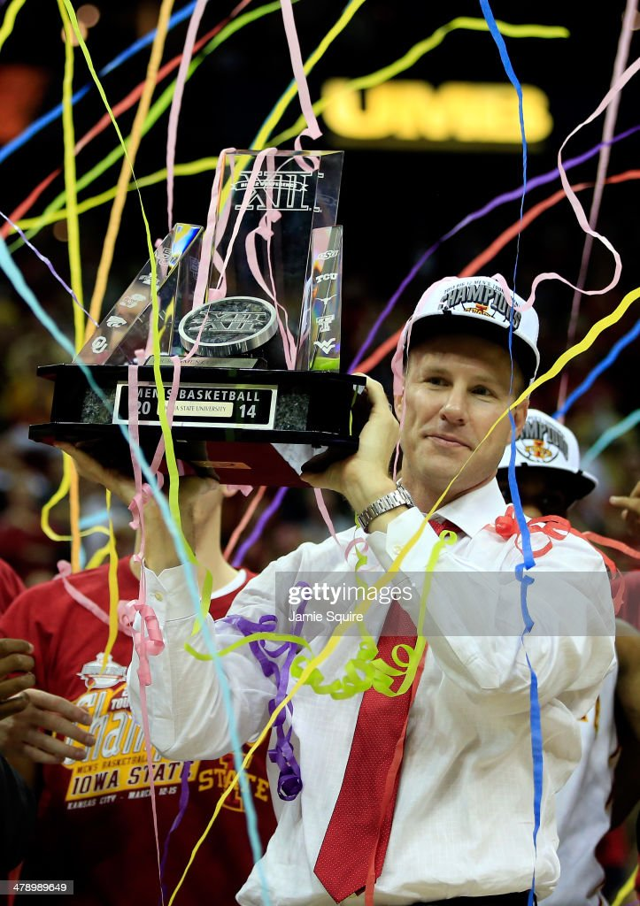 Head coach Fred Hoiberg of the Iowa State Cyclones holds up the trophy after winning the 2014 Big 12 Men's Championship over the Baylor Bears at the Sprint Center on March 15, 2014 in Kansas City, Missouri.