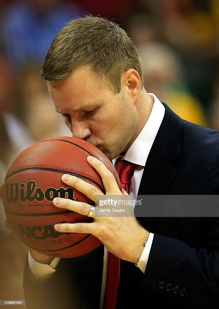 Head coach Fred Hoiberg of the Iowa State Cyclones kisses the ball after it was knocked out of bounds against the Baylor Bears during the Big 12 Basketball Tournament final game at the Sprint Center on March 15, 2014 in Kansas City, Missouri.