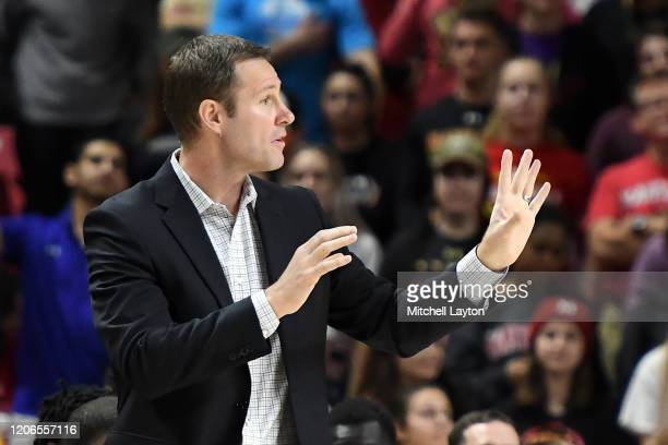 Head coach Fred Hoiberg of the Nebraska Cornhuskers signals to his players during a college basketball game against the Maryland Terrapins at the...