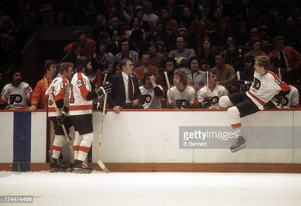 Head coach Fred Shero of the Philadelphia Flyers looks on from the bench during an NHL game circa 1976 at the Spectrum in Philadelphia Pennsylvania