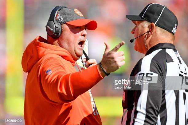 Head coach Freddie Kitchens of the Cleveland Browns argues with side judge Mark Stewart during the second quarter against the Seattle Seahawks at...