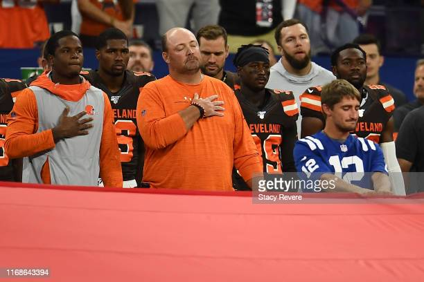 Head coach Freddie Kitchens of the Cleveland Browns stands for the National Anthem prior to a game against the Indianapolis Colts at Lucas Oil...