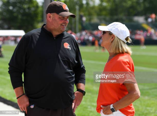 Head coach Freddie Kitchens of the Cleveland Browns talks with owner Dee Haslam after a training camp practice on July 25 2019 at the Cleveland...