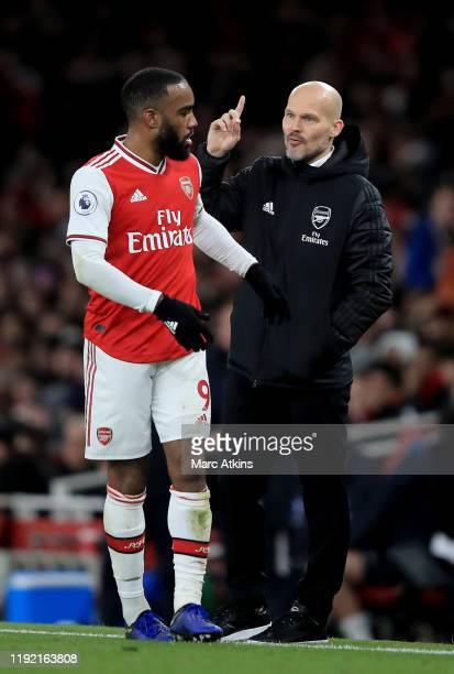 Head coach Freddie Ljungberg of Arsenal speaks to Alexandre Lacazette of Arsenal during the Premier League match between Arsenal FC and Brighton Hove...