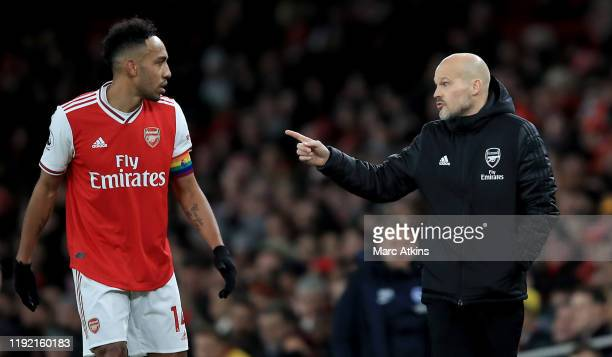 Head coach Freddie Ljungberg of Arsenal speaks to Pierre Emerick Aubameyang of Arsenal during the Premier League match between Arsenal FC and...