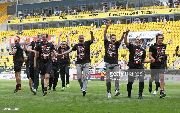Head coach Friedhelm Funkel and his team jubilate after moving up into the Bundesliga after the Second Bundesliga match between SG Dynamo Dresden and...