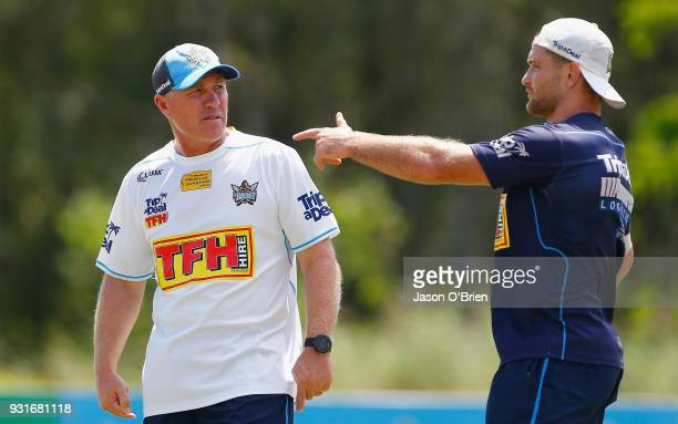 Head Coach Garth Brennan talks with Mitch Rein during a Gold Coast Titans NRL training session at Parkwood on March 14 2018 in Gold Coast Australia