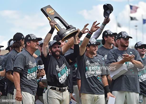 Head coach Gary Gilmore and player Anthony Marks of the Coastal Carolina Chanticleers celebrate with the team after defeating the Arizona Wildcats 43...