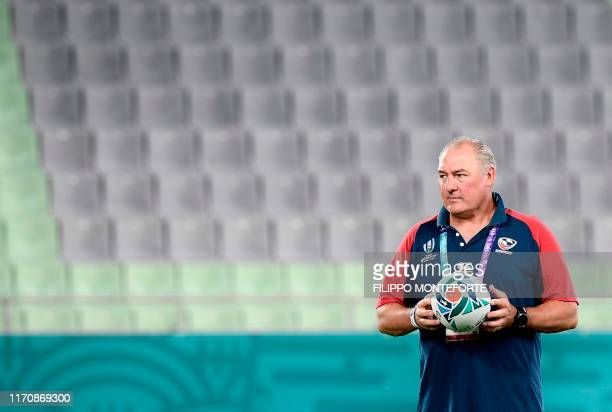 US head coach Gary Gold holds a ball during the Captain's Run training session at Kobe Misaki Stadium in Kobe on September 25 on the eve of their...