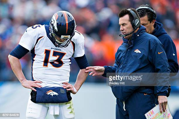 Head Coach Gary Kubiak and Trevor Siemian of the Denver Broncos talk during a timeout against the Tennessee Titans at Nissan Stadium on December 11...