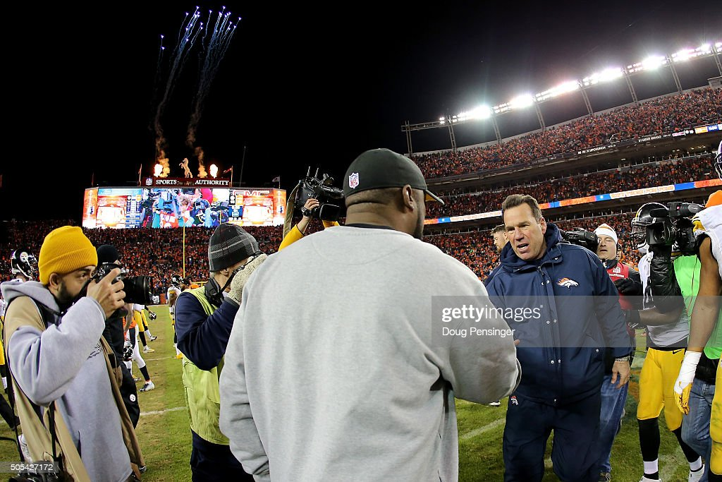 Head coach Gary Kubiak of the Denver Broncos and head coach Mike Tomlin of the Pittsburgh Steelers meet on the field after the AFC Divisional Playoff Game at Sports Authority Field at Mile High on January 17, 2016 in Denver, Colorado. The Denver Broncos beat the Pittsburgh Steelers 23-16.